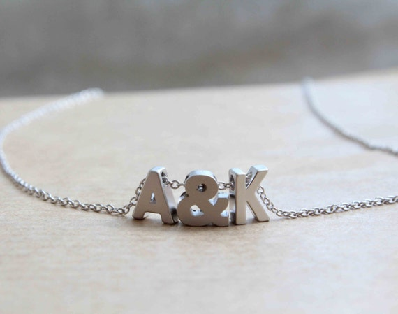Tiny silver letter necklace . Initial with ampersand symbol . Personalised necklace . Monogram necklace. Name necklace
