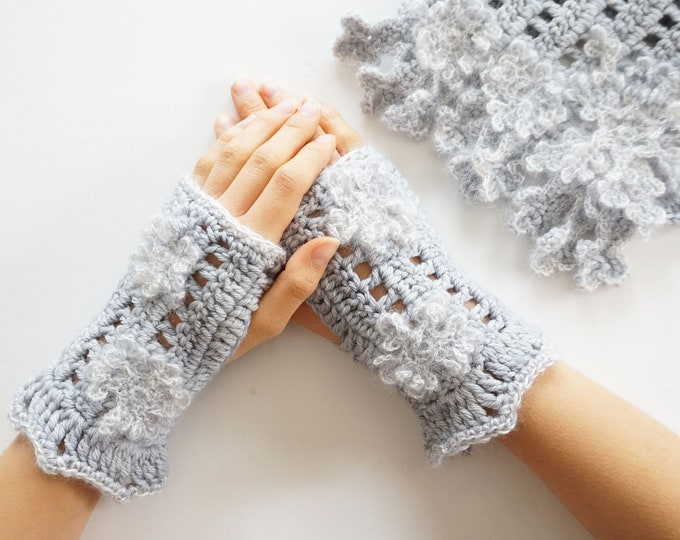 Snowflake arm warmers in a soft gray accented with various snowflakes in luxurious yarns, hand painted merino wool, silk and kid mohair
