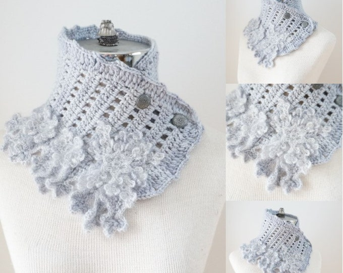 Snowflake scarf in a soft gray accented with various snowflakes in luxurious yarns including hand painted merino wool, silk and kid mohair