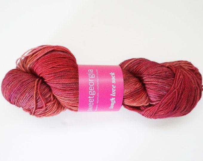 Pink Merino Wool Yarn, Fingerling Sock Yarn, Pink red with hints of orange, hand painted yarn, merino, SweetGeorgia Tough Love Sock yarn,