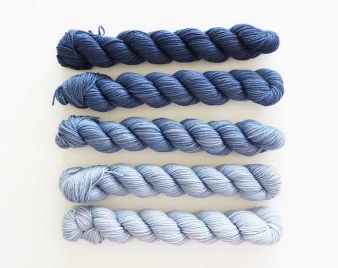 Blue Mini Skeins, Party of Five yarn by, Tough Love Sock Yarn, Sweetgeorgia Yarns, Voyage colour set from Navy to light blue gradient yarn
