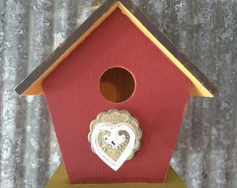 Colorful floral hand painted birdhouse