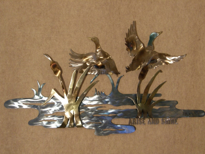 Metal Wall Sculpture of Ducks in Pond Setting image 0