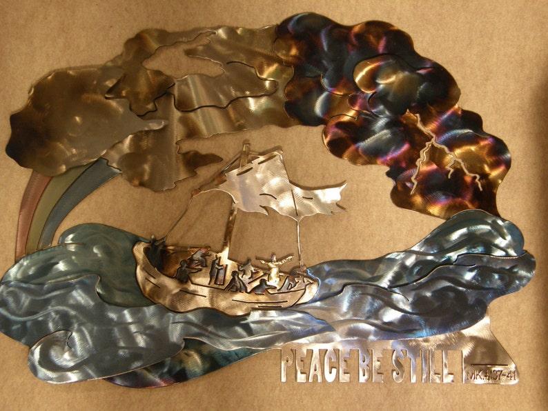 Metal wall sculpture of Jesus calming the sea image 0