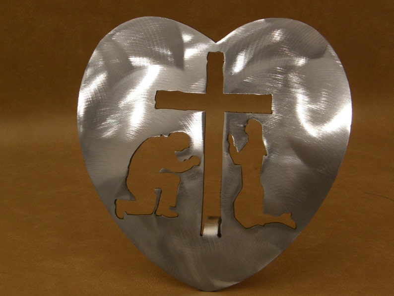 Heart metal sculpture with cutouts image 0