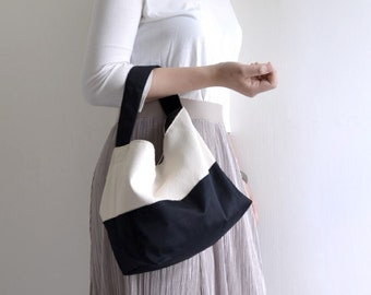 Classic top handle bag. Black and white woman shopping bag