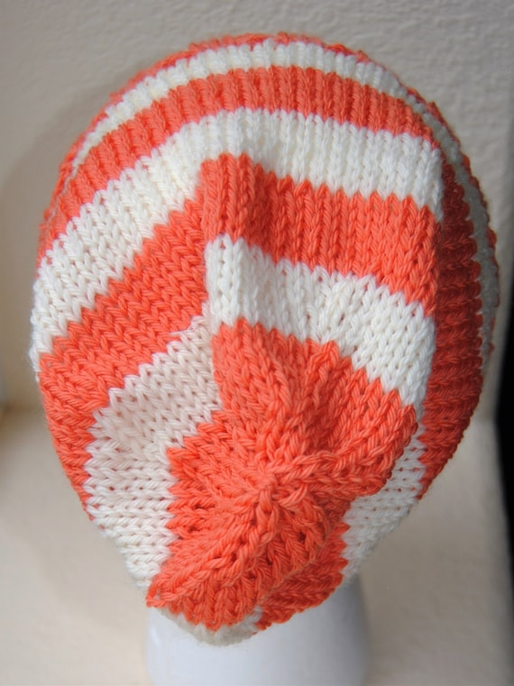 Light weight slouchy stocking hat. Stipes in orange and off white. 100%  wool. One size fits most. Ribbing is 4