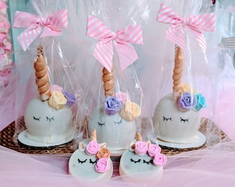 12 Unicorn Chocolate dipped candy apples individually wrapped with ribbon.  Unicorn party favors.