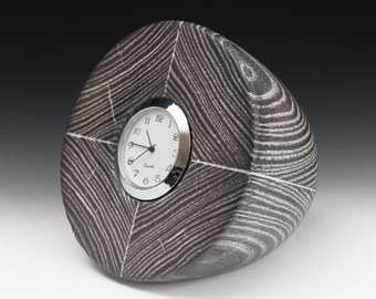 """Wood """"Capsule Clock"""" with unique scorched surface"""