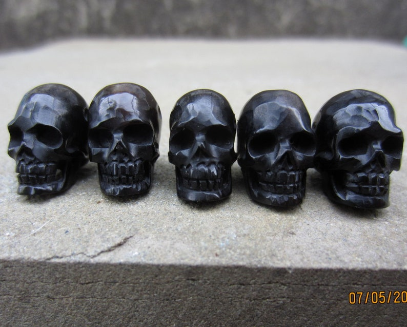 Hand Carved Buffalo Horn Skull Beads 5 piece Set Top to image 0
