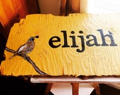 Custom name sign painted on driftwood
