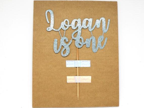 "Logan is one Cake Topper - Ready To Ship - 6.0"" width - Light Blue Glitter"