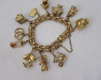 CHARM BRACELET MECHANICAL whimsical charms gold filled c 1960