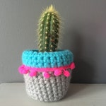 Cactus Cosy crocheted in Grey and Turquoise with neon pink pom poms by Chimps Tea Party