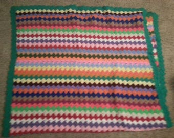 Vintage multi-striped, multi-colored afghan, green edges, 79 by 42 inches