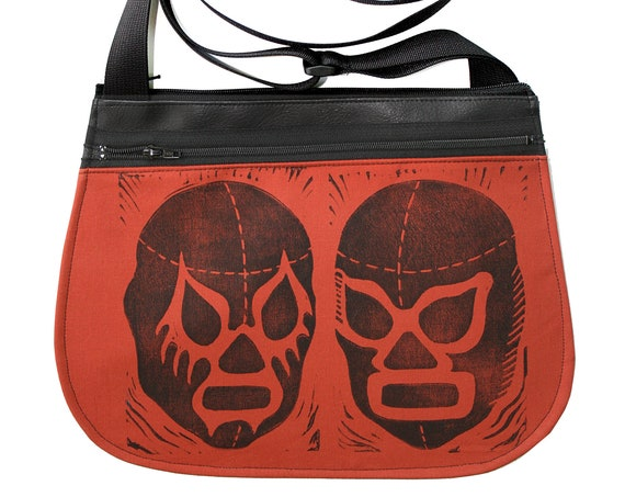 Luchadors, block print, burnt orange, black vinyl, cross body, vegan leather, zipper top