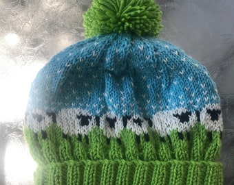 Hand knit adult's green, turquoise, black, and white pull on sheep hat