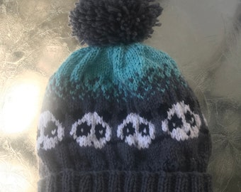 Hand knit child's Panda hat in turquoise, gray, and white
