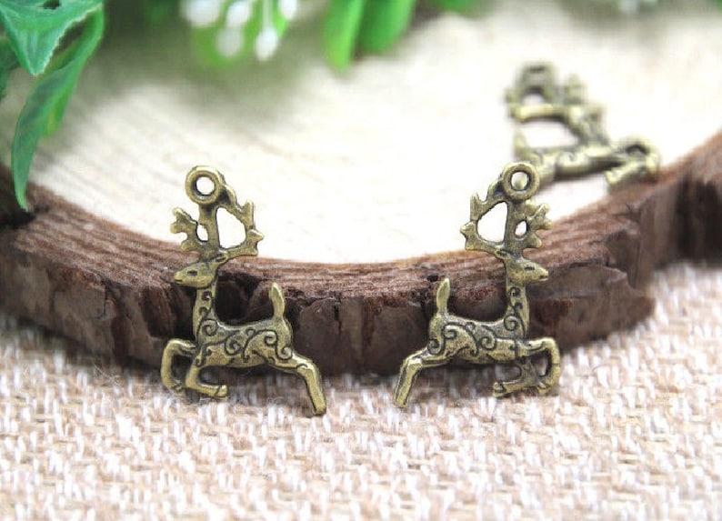 12 Deer Charms with Swirl Design Reindeer Christmas Animal Totem Bronze Animal Jewelry Supplies 20x14mm