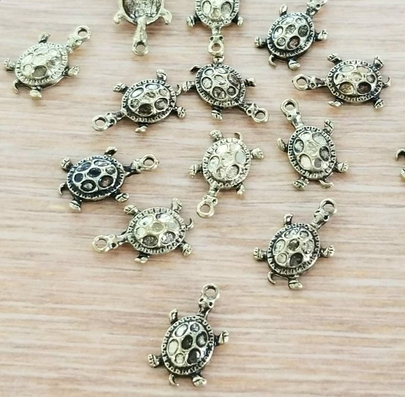 10 Dark Gold Turtle Charms Antique Brass with Varying Dark Contrast Little Totem Spirit Animal Jewelry Supplies 16x10mm