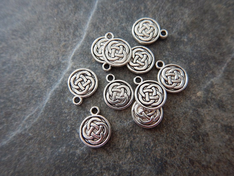286a0a30d 10 Celtic Knot Design Small Round Charms Varying Dark Contrast | Etsy