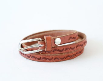 Crescent moon belt | vintage 70s crescent moon tooled leather belt  | 1970s Brass buckle thin leather belt