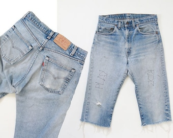 Levis cut off jeans | Vintage 70s 80s Levis red tab light wash Graffiti blue jeans shorts USA