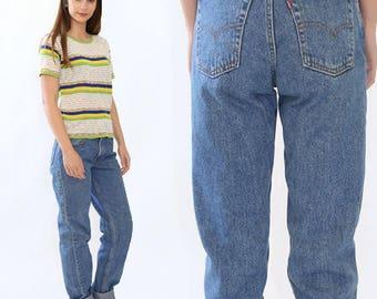 Vintage 80s red tab Levis medium wash blue jeans USA skinny straight leg W31 L36