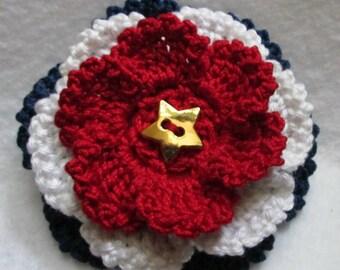 Handmade crochet flower in red, white and blue
