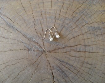 """Earrings... """"Spun"""" pearl earrings wire wrapped with sterling silver."""