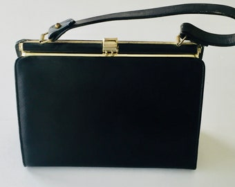 01cd8a9a2f25 Triangle - New York Black Handbag