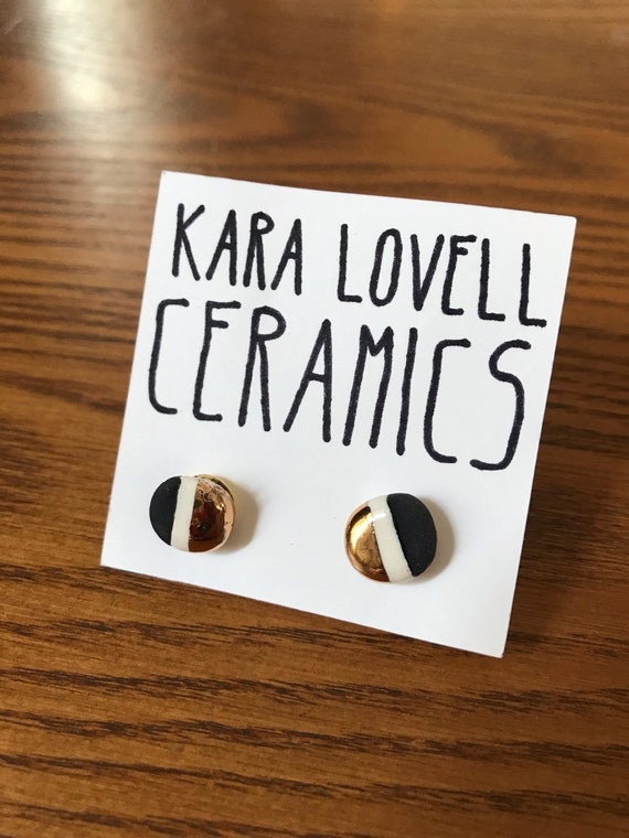 Black, white and gold ceramic studs