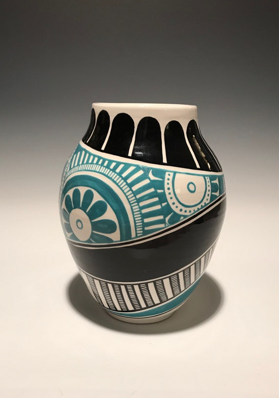 Asymmetrical pot with turquoise