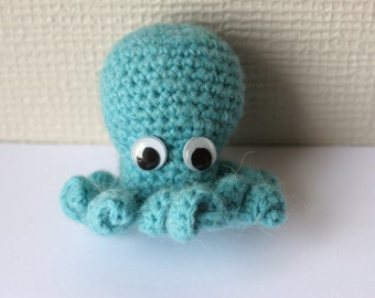 Small hand crocheted blue octopus