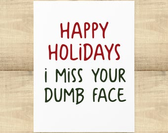 Happy Holidays I Miss Your Dumb Face greeting card with matching envelope, BLANK INSIDE