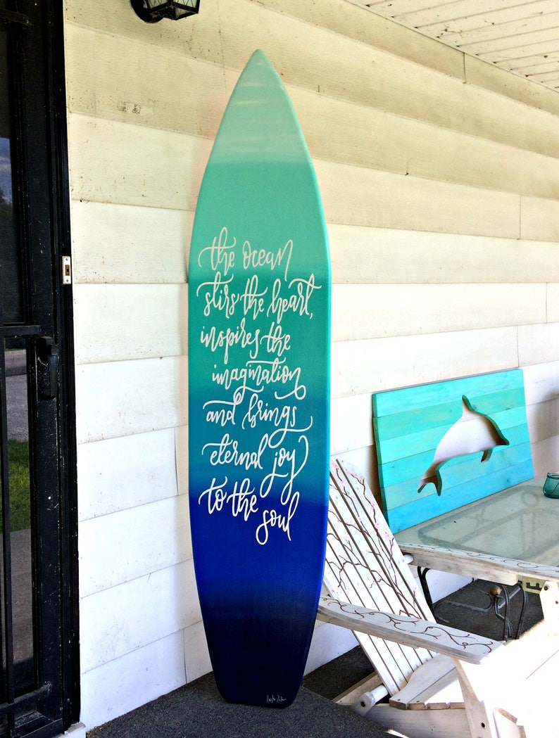 6 foot wood surfboard wall art in an ocean ombre effect with quote sign