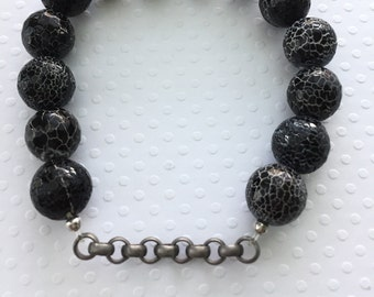 Mens bracelet. Handmade jewelry. Stretch bracelet. Black crackle beads with silver link chain bracelet. Black and white. Sugarplum Gallery.