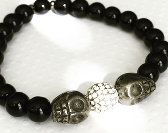 Mens bracelet. Handmade jewelry. Stretch bracelet. Skull bracelet. Black beaded bracelet. Pave Bracelet. Unique bracelet. Sugarplum Gallery.