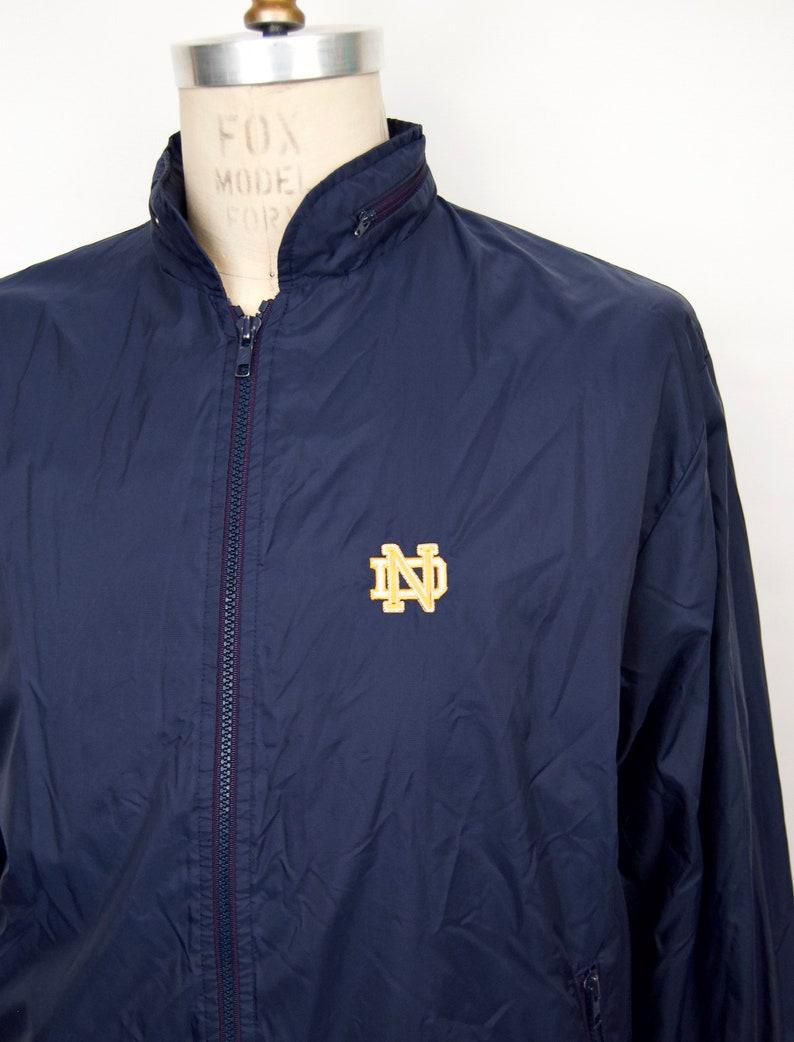 1980s Notre Dame Jacket w zip-collar rain hood /& terry cloth lining  navy blue nylon windbreaker  men/'s extra large