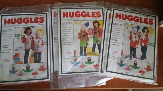 5 Huggles All purpose smocks with pocket, two Hopp