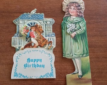 Two pop up, shaped greeting cards. 1984 and 1985 Merrimack Publishing Corp., 85 Fifth Ave., N.Y.
