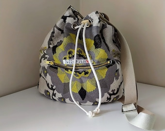 Tapestry cross body bag with adjustable strap