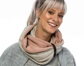 Infinity scarf - mocha pattern and blush pink, accessorized with a leather band