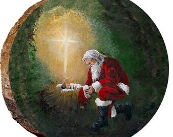 santa kneeling at manger dx134
