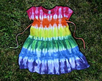 Rainbow tie-dye short-sleeved dress with ties, tiers, and maybe a pink heart!