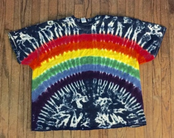 Rainbow on dark blue tie-dye tee