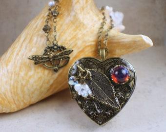 Music box pendant etsy real leaf music box locket photo locket music box locket botanical locket heart shaped locket music box necklace rose leaf pendant aloadofball Images