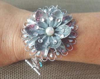 Silver ice blue flower focal bracelet with hand beaded chain and toggle clasp