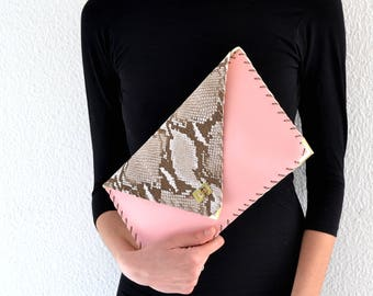 Pink and snake print leather clutch