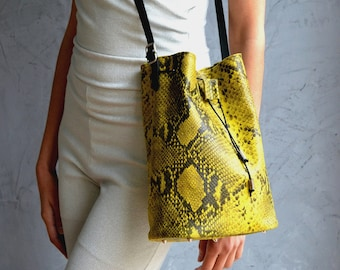 Aithra Yellow Snake Bucket Bag